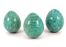 Polished and natural crystals, spheres, freeforms and pebbles of  Amazonite