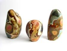 Polished and natural crystals, spheres, freeforms and pebbles of  Jasper
